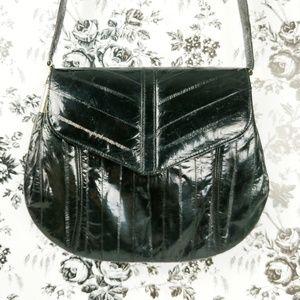 Vtg Leather of the Sea black genuine eel skin bag